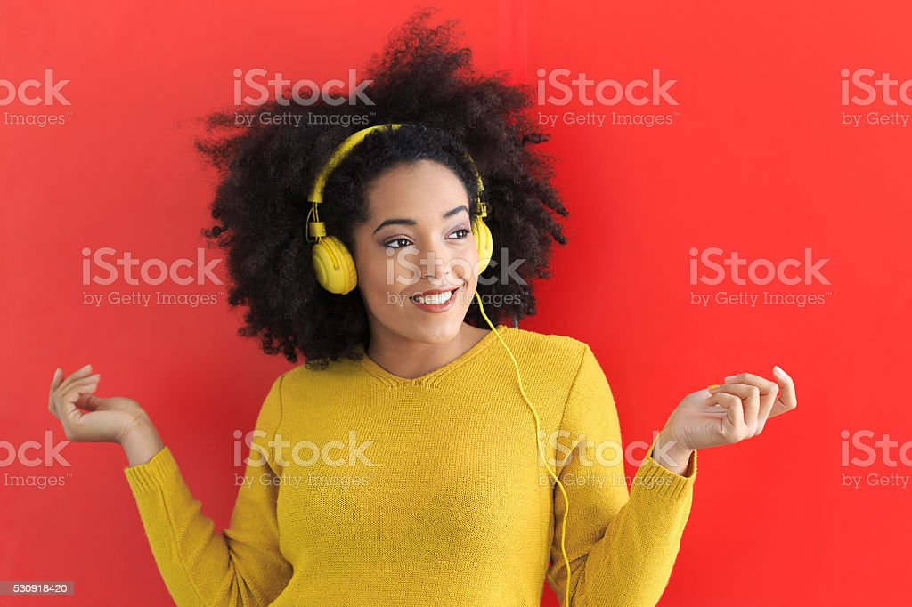 Smiling afro woman with yellow headphones stock photo