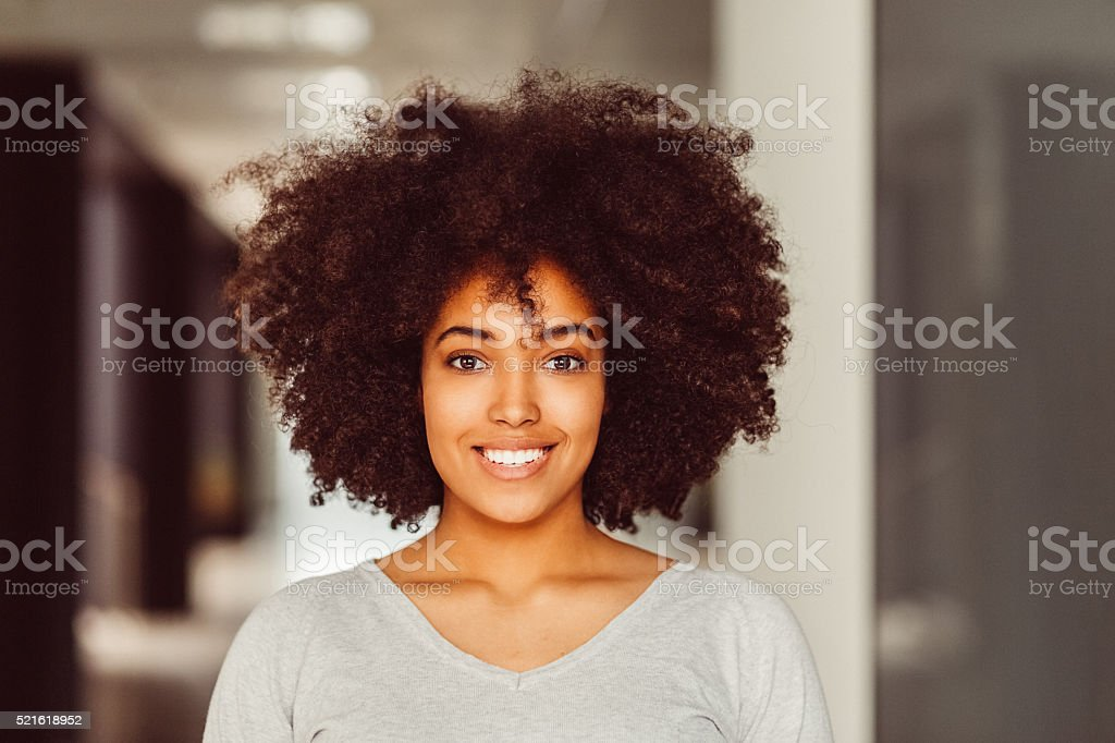 Smiling afro-american woman looking at camera stock photo