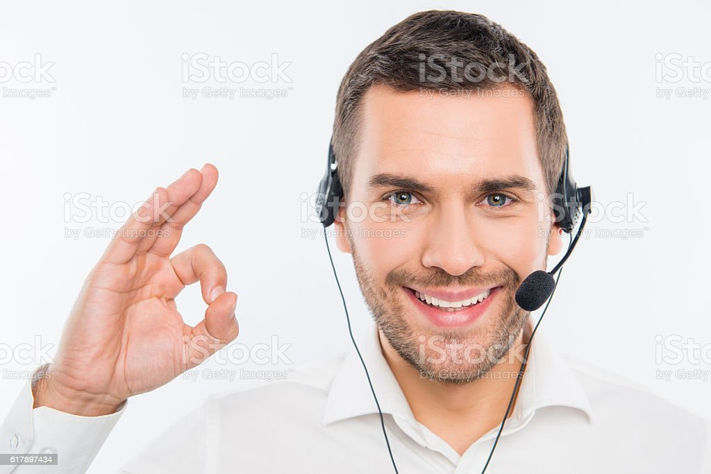 Smiling agent of call centre gesturing 'OK' stock photo