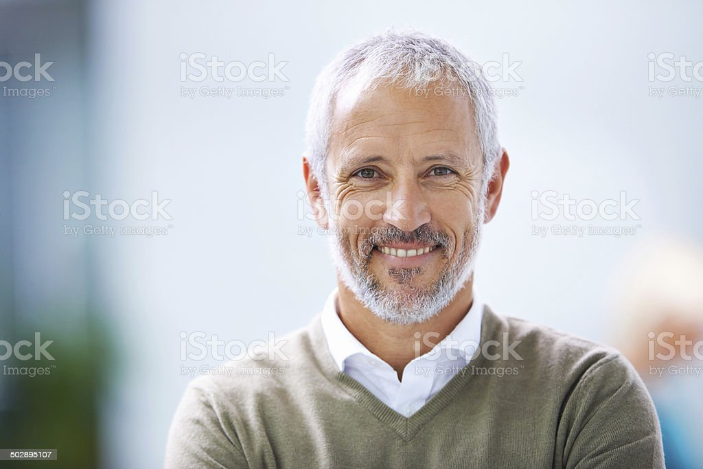 Smiling all the way to success stock photo