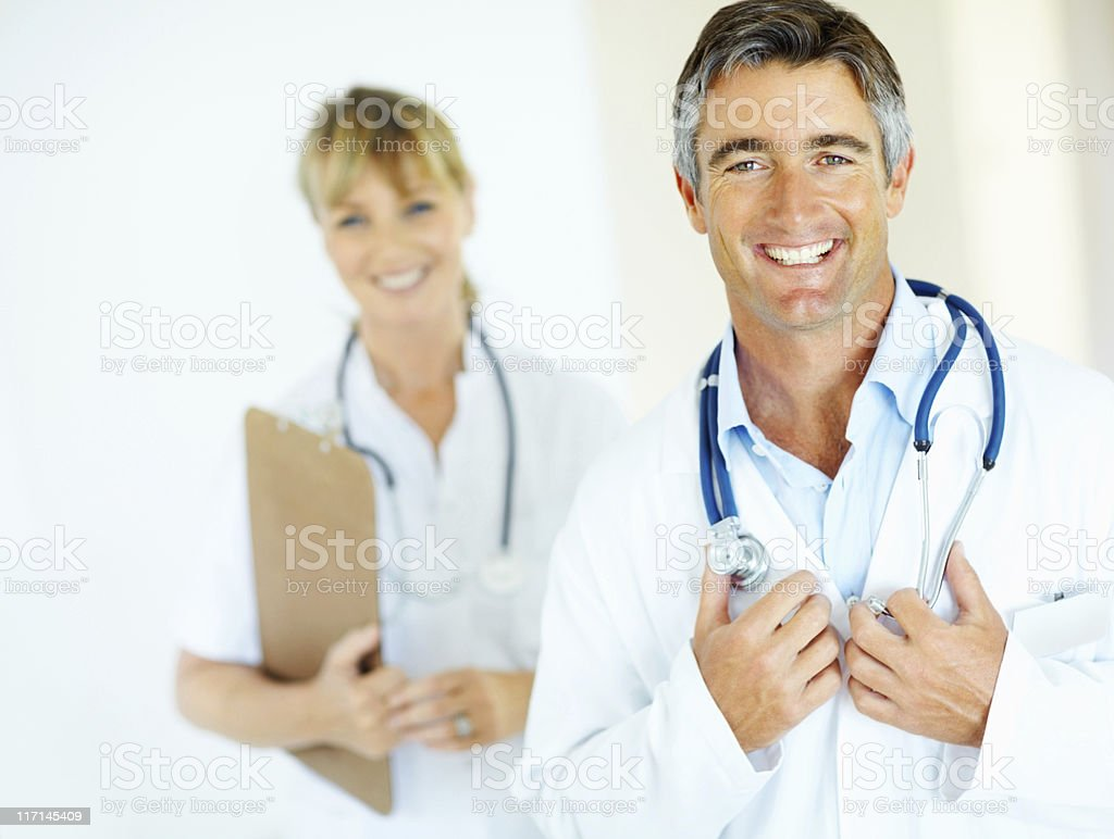 Smiling and confident male doctor at hospital royalty-free stock photo