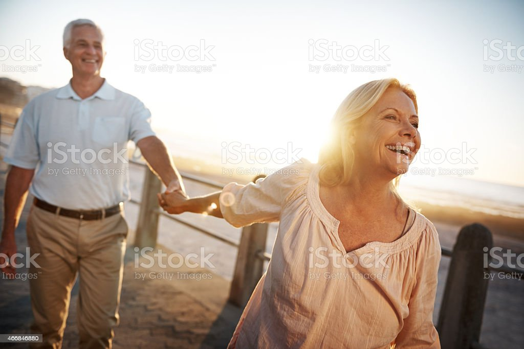 Smiling and laughing together stock photo