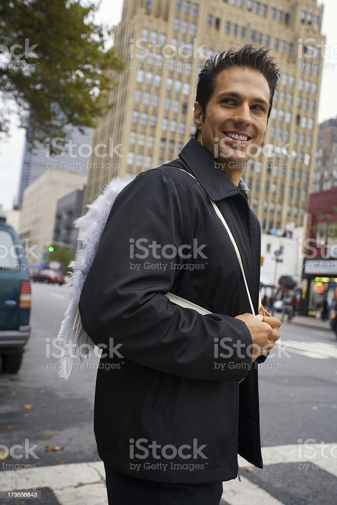 Smiling angel on the streets of NYC royalty-free stock photo
