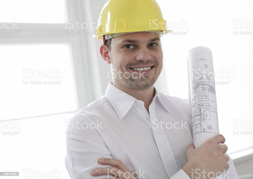 smiling architect with helmet and blueprint royalty-free stock photo