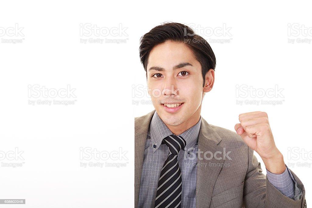 Smiling Asian businessman stock photo