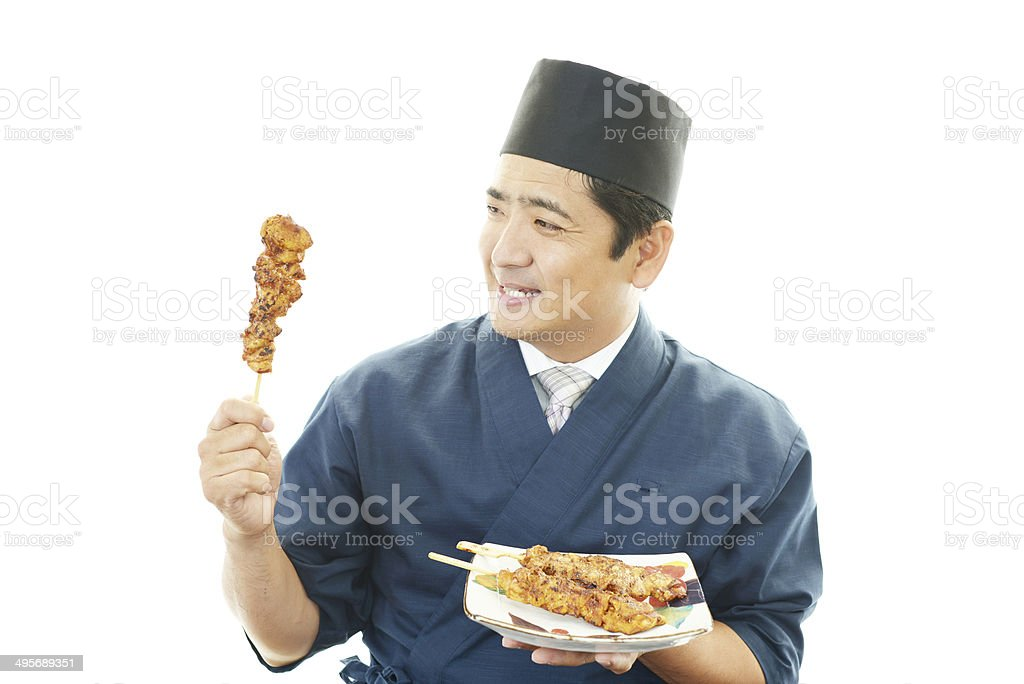 Smiling Asian chef stock photo