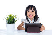 Smiling Asian Chinese little office lady with tablet