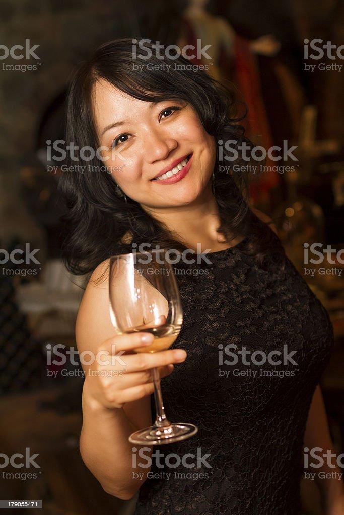 Smiling Asian girl wine tasting in Napa royalty-free stock photo