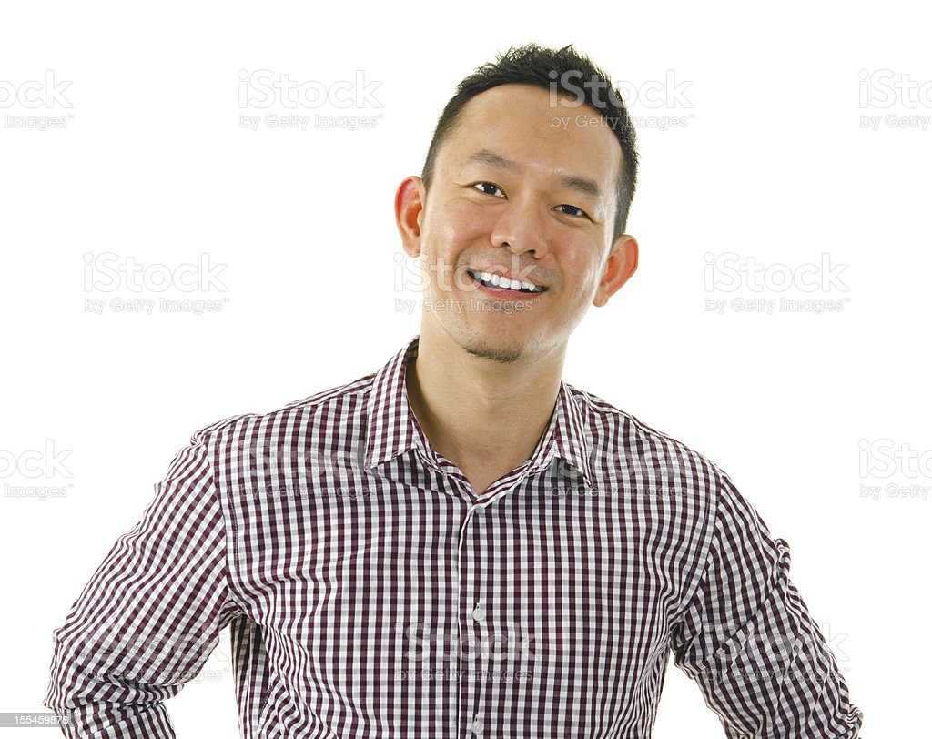 A smiling Asian man in a checkered shirt stock photo