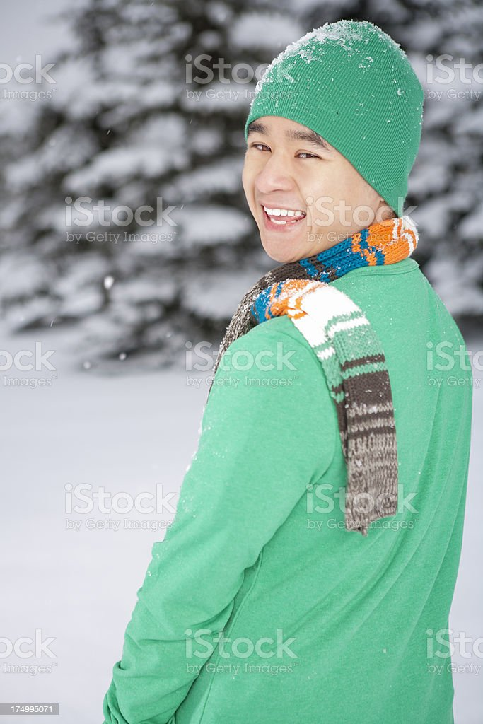 Smiling asian man winter portrait royalty-free stock photo