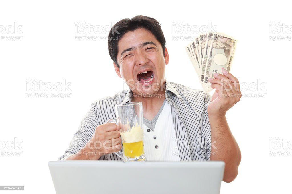 Smiling Asian man with money stock photo