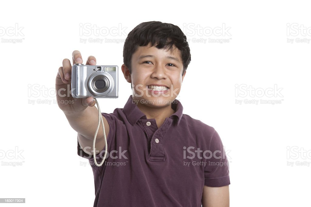 Smiling Asian Teenager with Digital Camera Taking a Picture royalty-free stock photo