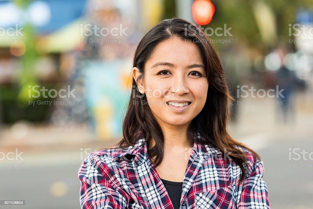 Smiling asian woman looking at the camera stock photo