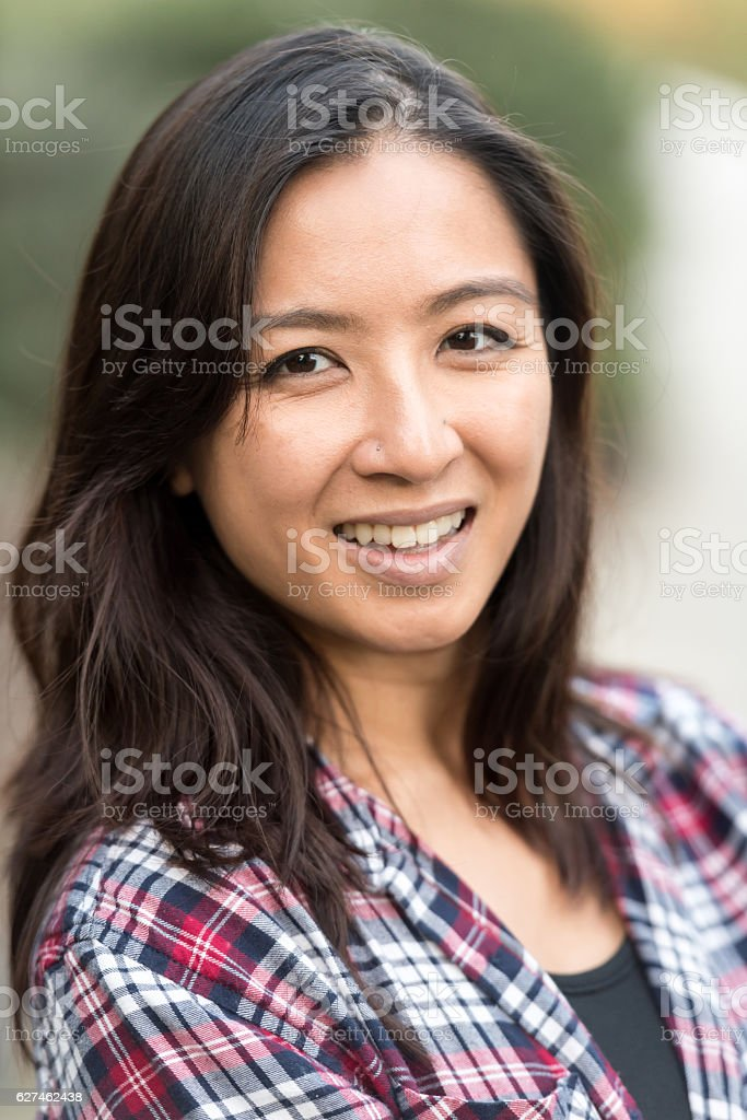 Smiling asian woman looking at the camera stock photo