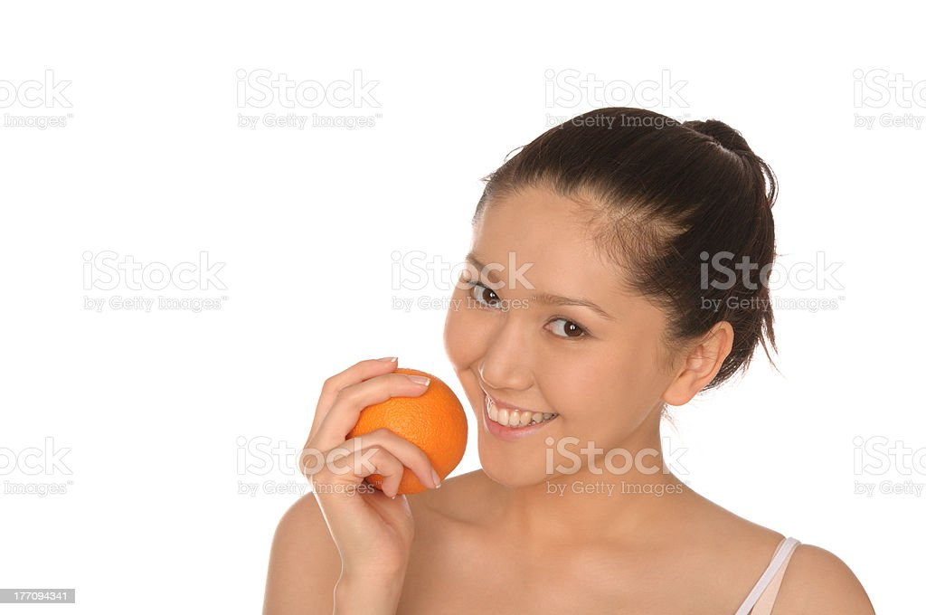 smiling asian woman with orange royalty-free stock photo