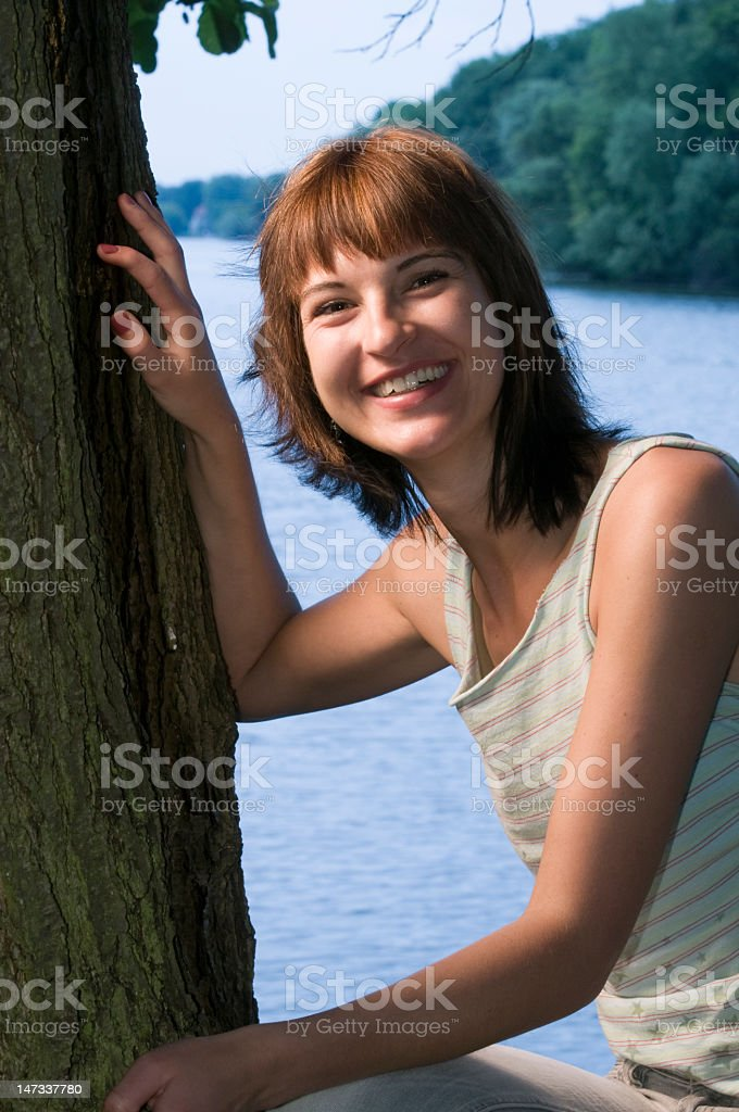 smiling at the tree stock photo