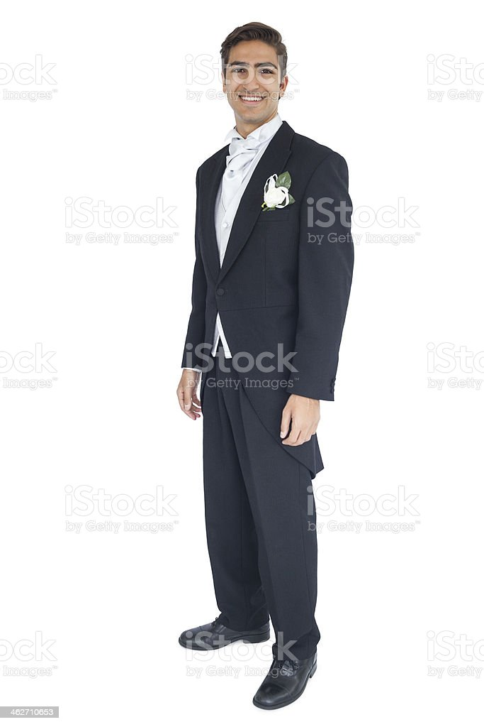 Smiling attractive groom looking at camera stock photo