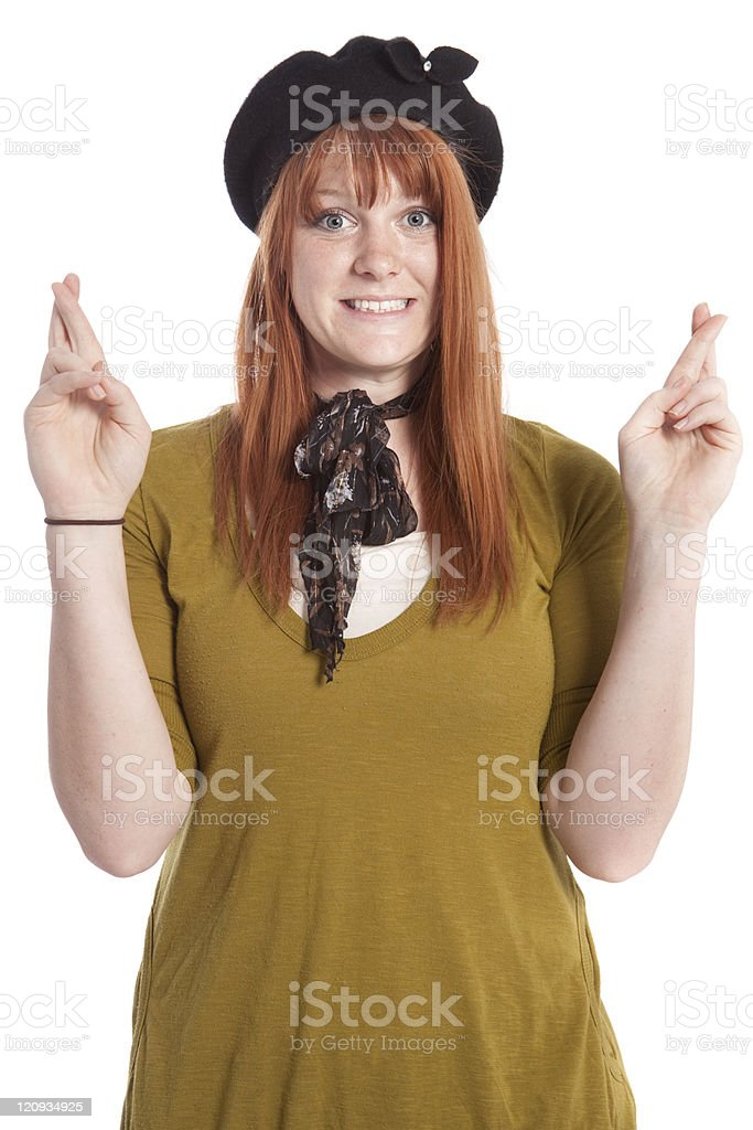 Smiling Attractive Woman with Fingers Crossed Isolated royalty-free stock photo