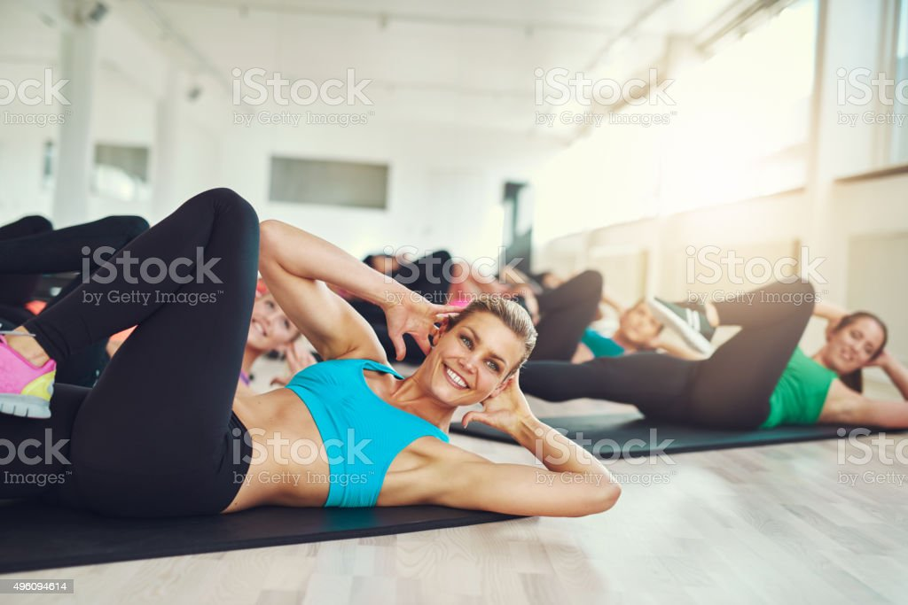 Smiling attractive young woman doing aerobics stock photo