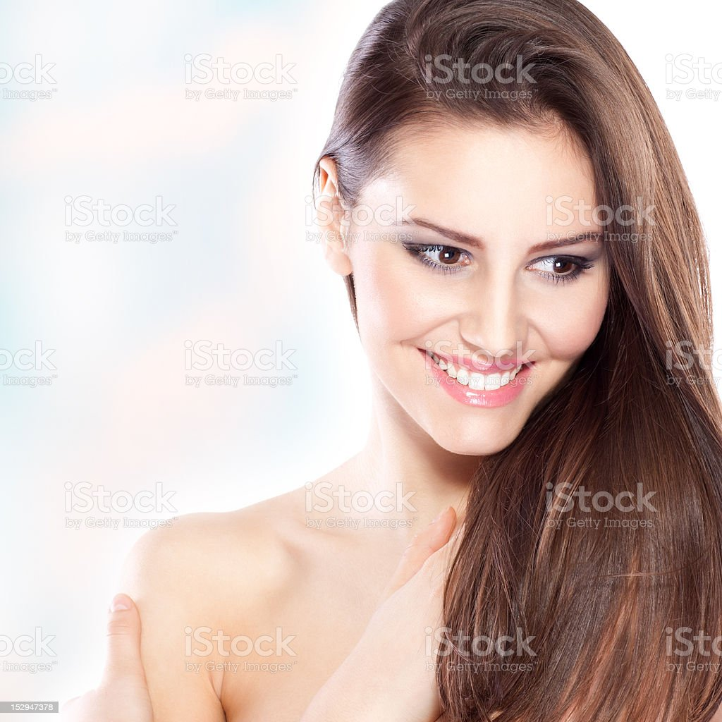 Smiling attractive young woman, with long brown hair, royalty-free stock photo