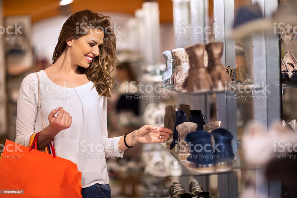 Smiling attractive young women shopping stock photo