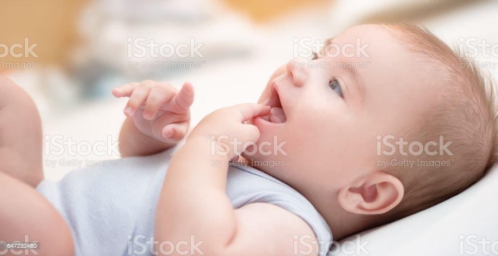Smiling baby boy stock photo