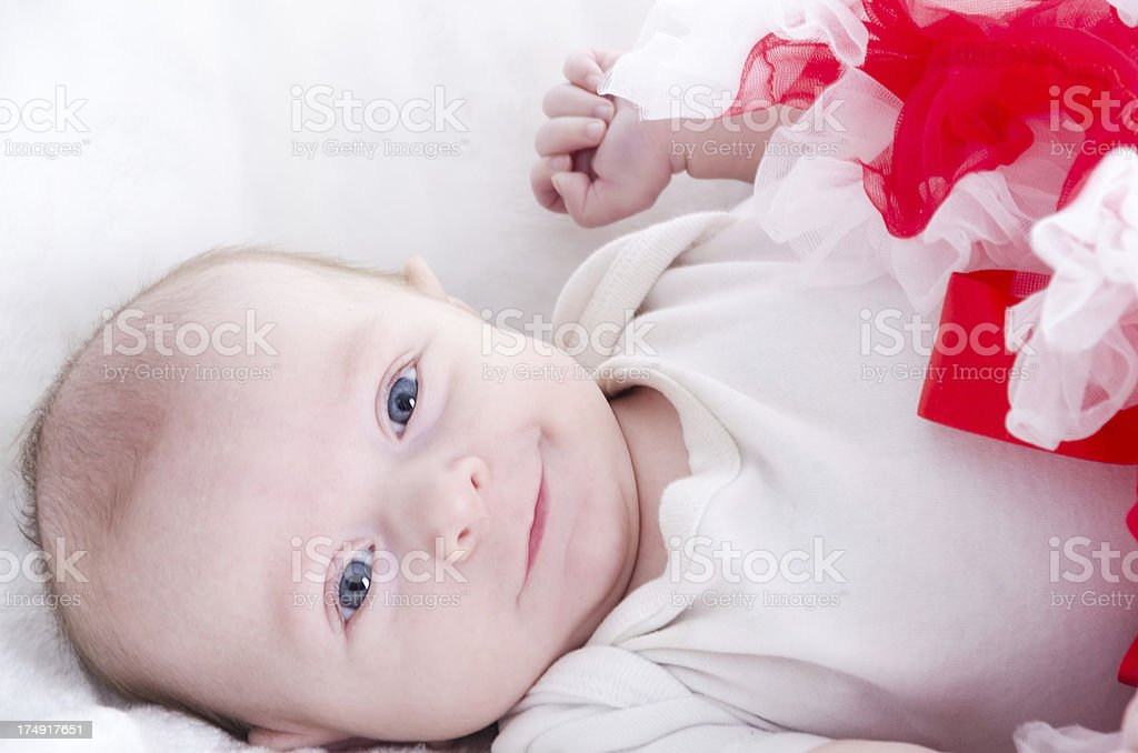 Smiling baby girl laying on back. royalty-free stock photo