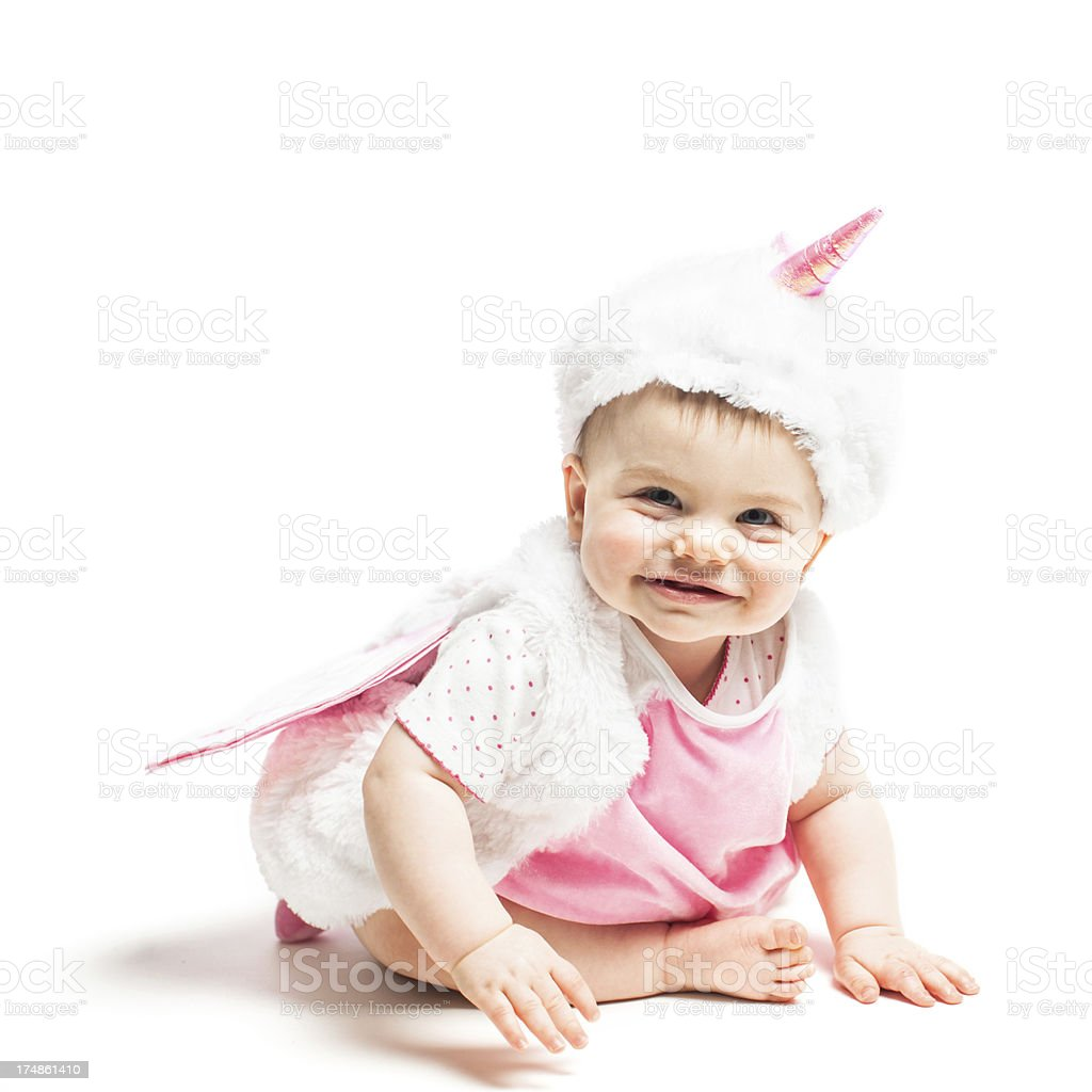 smiling baby in a unicorn costume royalty-free stock photo