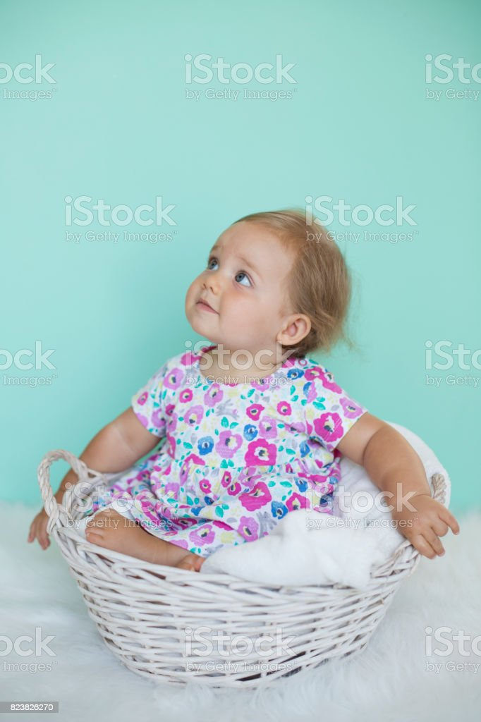 Smiling baby in basket stock photo