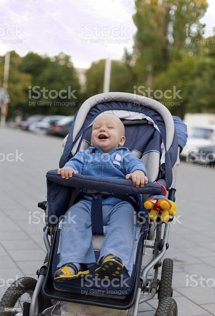 Smiling baby in sitting stroller #12 royalty-free stock photo