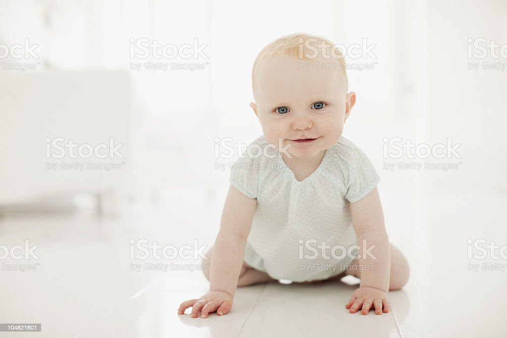 Smiling baby on floor royalty-free stock photo