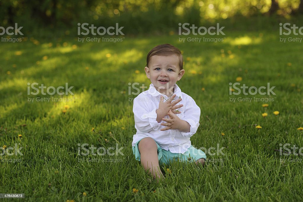 Smiling Baby Sitting on Grass royalty-free stock photo