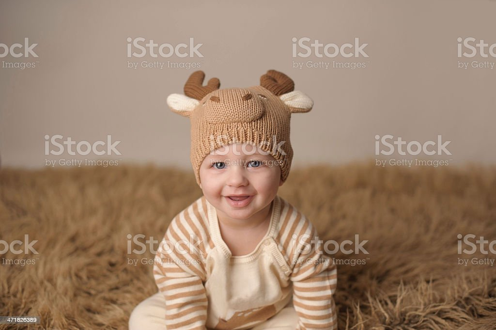 Smiling Baby Wearing Knit Outfit royalty-free stock photo