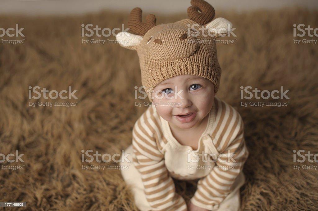 Smiling Baby Wearing Knit Reindeer Hat royalty-free stock photo