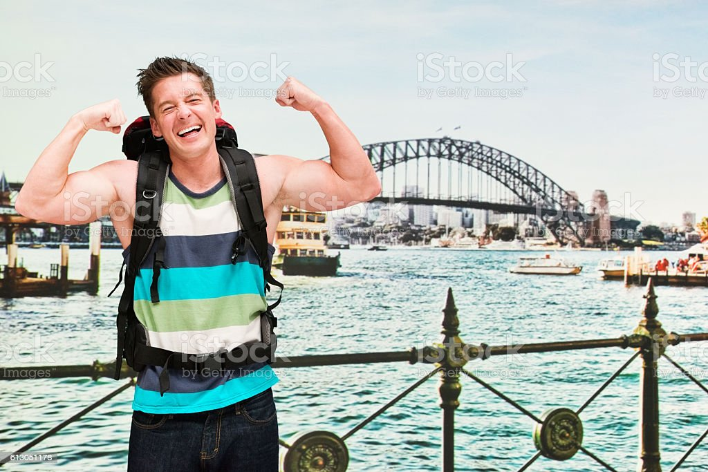 Smiling backpacker cheering outdoors stock photo