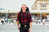 Smiling backpacker standing outdoors
