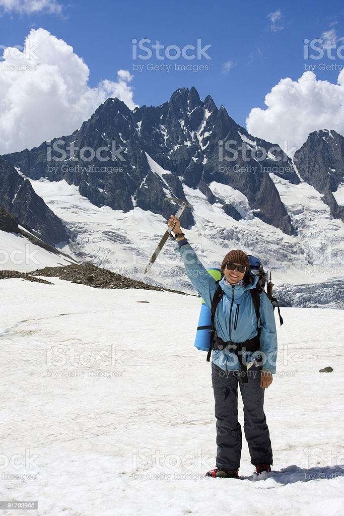 Smiling backpacker woman with ice-axe royalty-free stock photo