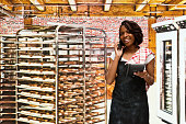 Smiling baker on phone in bakery