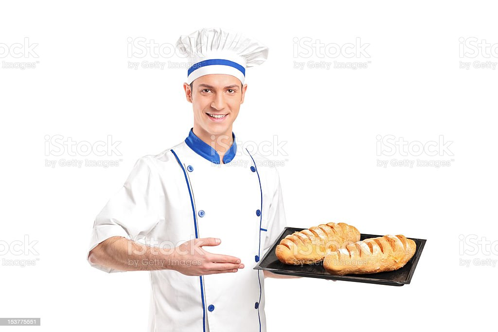 Smiling baker showing freshly baked breads royalty-free stock photo