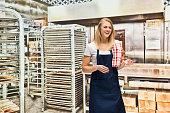 Smiling baker standing in bakery