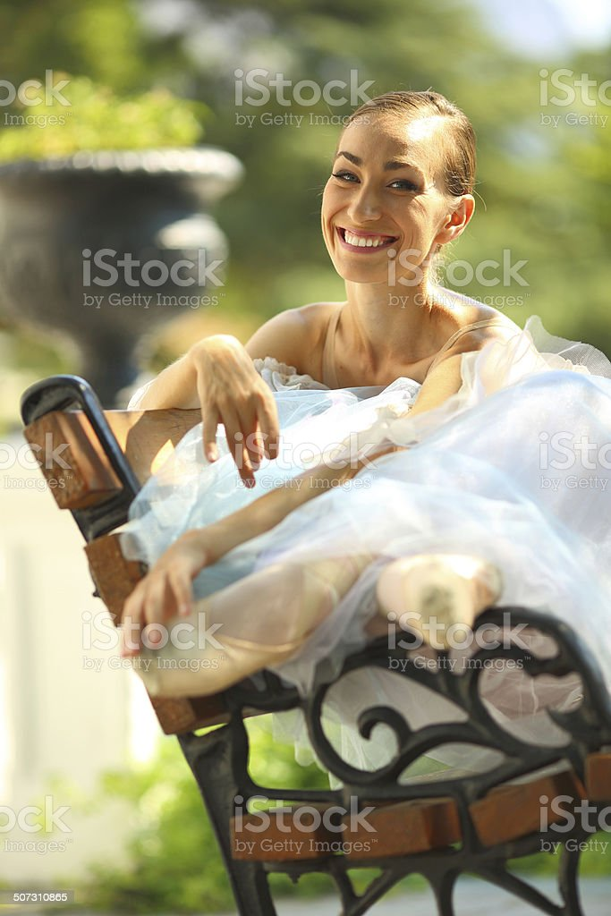 smiling ballerina on a park bench royalty-free stock photo