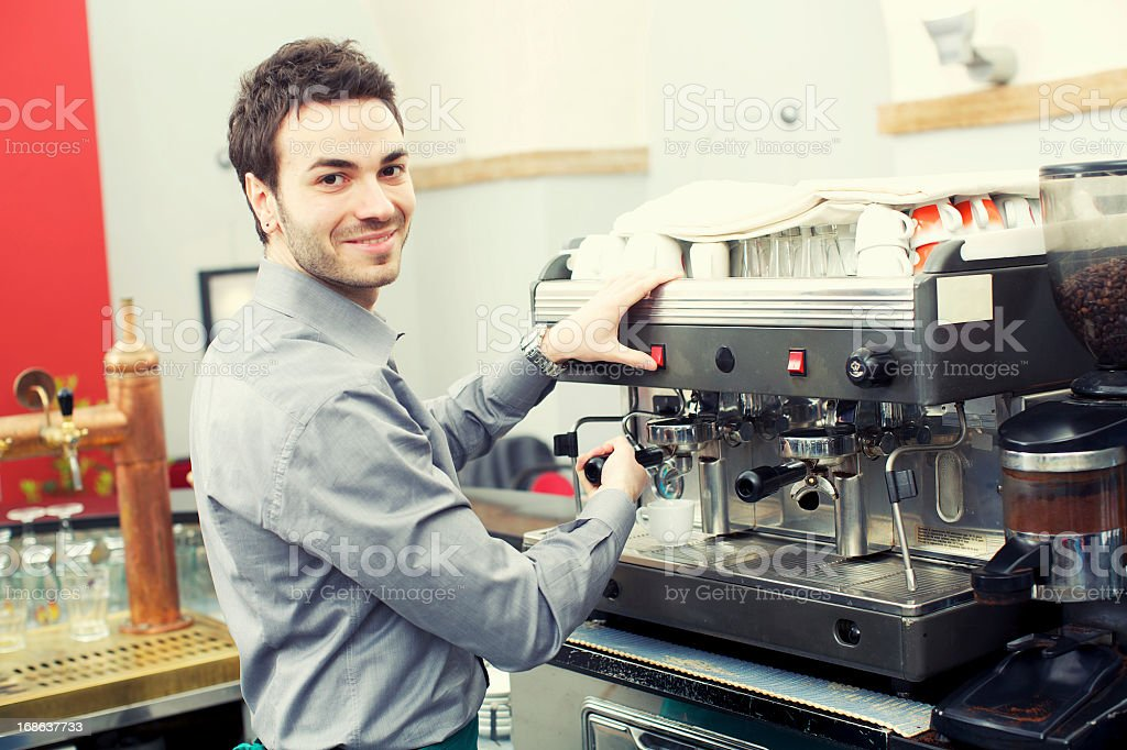 Smiling barman making a cafe royalty-free stock photo