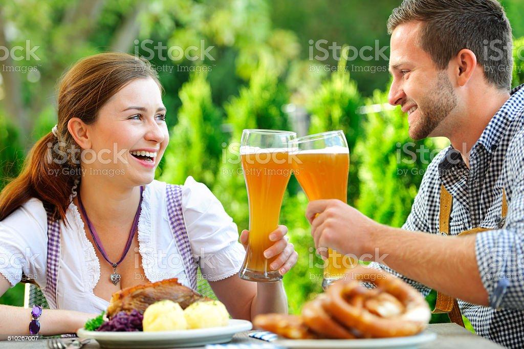 Smiling bavarian couple at Oktoberfest stock photo