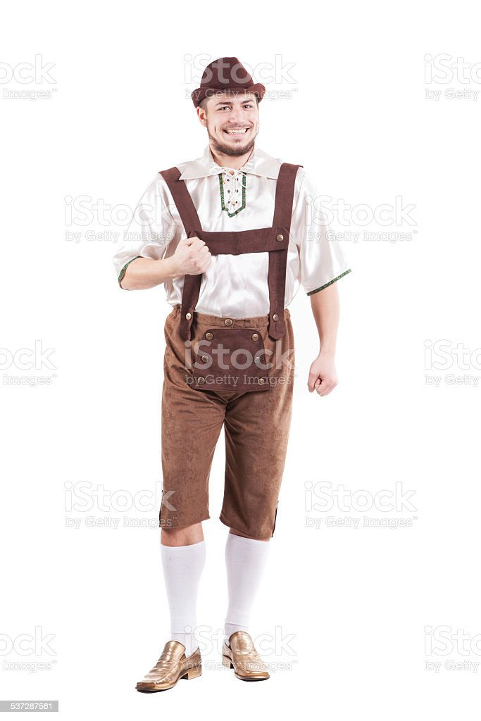 Smiling bavarian man in shirt and leather pants stock photo