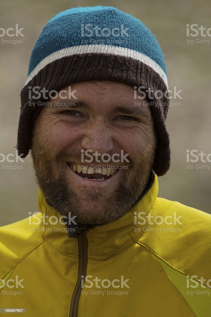Smiling bearded man in a hat royalty-free stock photo