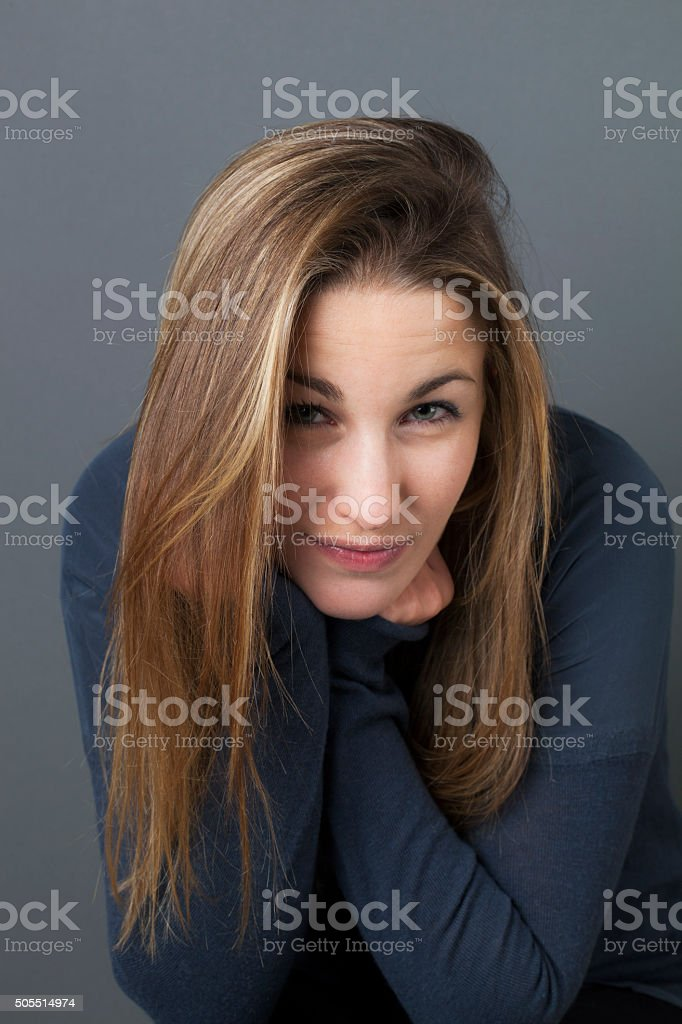 smiling beautiful 20s girl with bags leaning face on hands stock photo
