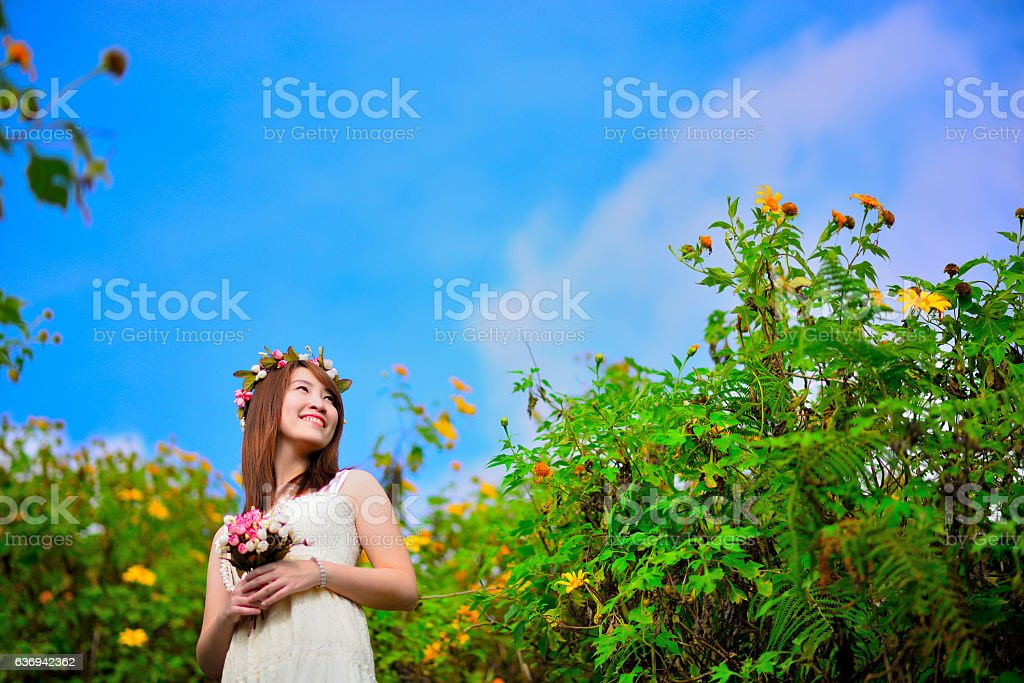 smiling beautiful bride wear long white dress in forest stock photo