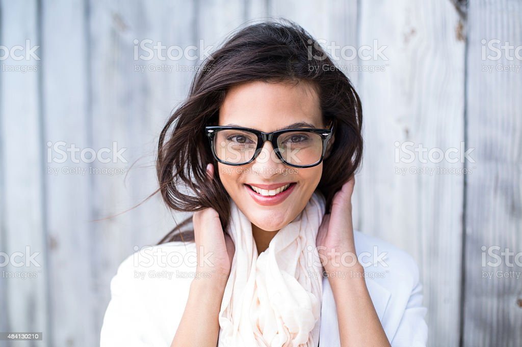 Smiling beautiful brunette looking at camera stock photo