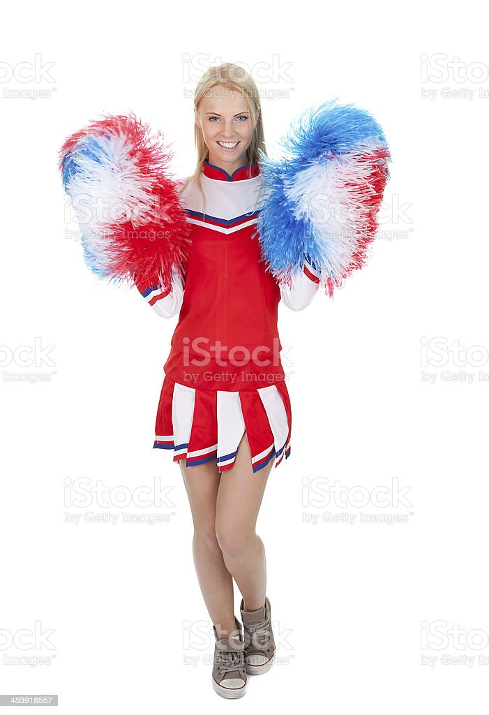 Smiling beautiful cheerleader with pompoms. royalty-free stock photo
