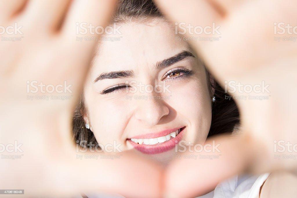 Smiling beautiful girl winking stock photo